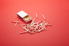 Matchbox over red backdrop. Matchbox and some matches over a red backdrop Stock Photography