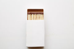 Matchbox. And some matches over a white backdrop royalty free stock images