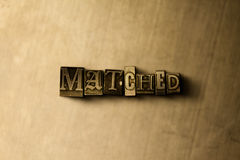 MATCHED - close-up of grungy vintage typeset word on metal backdrop Royalty Free Stock Photo