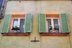 Matched Flower Pots in Sienna Windows Royalty Free Stock Photography