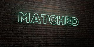 MATCHED -Realistic Neon Sign on Brick Wall background - 3D rendered royalty free stock image Royalty Free Stock Image