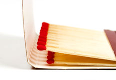 Matches. A closeup view of red-tipped matches, in an open matchbox Royalty Free Stock Photos