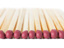 Matches. Macro view of row of matches isolated over white Stock Photography