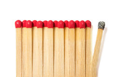Matches. With bright red gray on a white background, one of them do not like it Royalty Free Stock Image