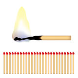 Matches. A burning matchstick and lots of red matches Stock Photos