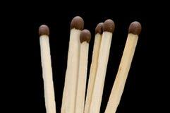 Matches on black Stock Photo