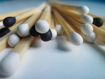 Matches with black and white heads. On the white background royalty free stock photography