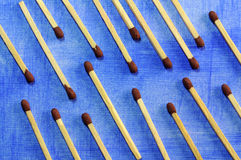 Matches on blue. Matche displayed in a decorative way on a blue background Stock Photos