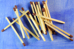 Matches on blue. Matches  on a blue background Royalty Free Stock Images