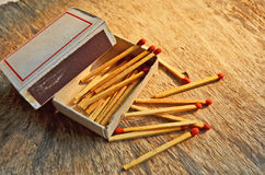 Matches and box on the floor. Matches and paper box on the wood floor Royalty Free Stock Image