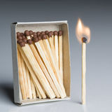 Matches Box and One Match In Fire, Matchstick Burning Flame Idea. Matches Box and One Match In Fire, Matchstick Burning Flame as Innovation Idea, Team Leader stock photo