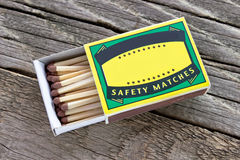 Matches box. On wooden background Stock Photos