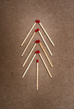 Matches on a brown background Royalty Free Stock Images