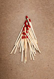 Matches on a brown background. / template Royalty Free Stock Image