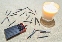 Matches and candle Stock Photo