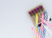 Matches and candles for birthday party. Matches and colorful candles for birthday party Stock Photography