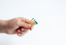 Matches in child hand isolated on white. Matches in children hand isolated on white royalty free stock photos
