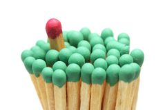 Matches closeup isolated. Red in group of green Royalty Free Stock Photo