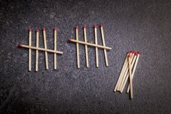 Matches, dark background royalty free stock photos