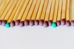 Matches of different colors on a white background royalty free stock photo