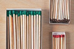 Matches of different length and thickness. In different matchboxes Royalty Free Stock Photography
