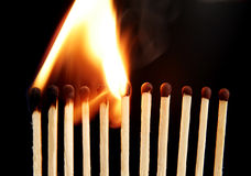 Matches in fire Stock Photography
