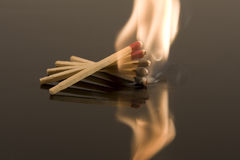 Matches on fire. A stack of matches goes up in flames Stock Images