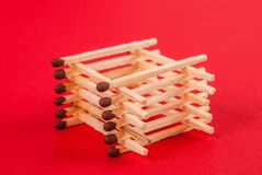 Matches in the form of bonfires. Matches stick in the form of bonfires isolated on red background royalty free stock images