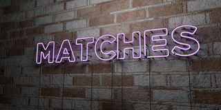 MATCHES - Glowing Neon Sign on stonework wall - 3D rendered royalty free stock illustration Royalty Free Stock Photography