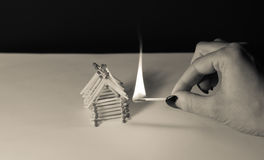 Matches house and hand with burning fire - risk of accident Royalty Free Stock Image