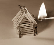 Matches house and match with burning fire - risk of accident Stock Images
