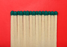 Matches isolated on a red textured background. Matches isolated on a red textured background / 12 Stock Photography