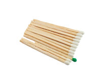 Matches isolated on a white background. One match of green color and is a lot of matches of white color Stock Images