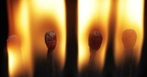 Matches light up one by another in series on black background.  stock footage