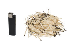 Matches & lighter. Lighter on the left and handful of wooden matches on the right stock image