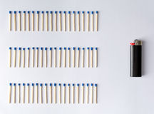 Matches and a lighter in front of a white background Stock Photography