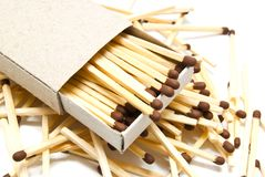 Matches and matchbox on white Royalty Free Stock Photo
