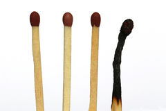 Matches with one burned out Stock Photos