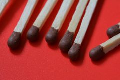 Matches on red background Stock Image