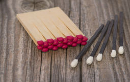 Matches red and black. Matches on a dark surface Royalty Free Stock Images