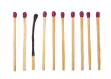 Matches on a row. Matches on a row with one burned down Stock Photo
