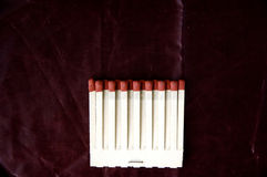 Matches row on deep red background Royalty Free Stock Photo