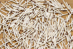 Matches are scattered randomly on the floor. Stock Photos