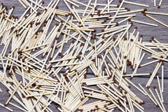 Matches are scattered randomly on the floor. Stock Image
