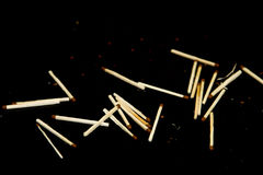 Matches are scattered randomly on a table. Royalty Free Stock Photo