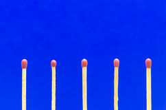 Matches setting on blue  background for ideas and inspiration Royalty Free Stock Photography