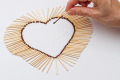 Matches in the shape of a heart and a burning match Stock Image