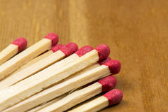 Matches. Some matches on wooden background stock image
