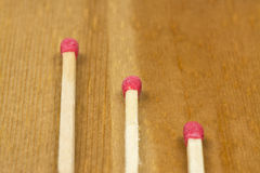 Matches. Some matches on wooden background royalty free stock photography