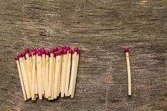 Matches on wooden background. Concept of loneliness, allocation from crowd Stock Image